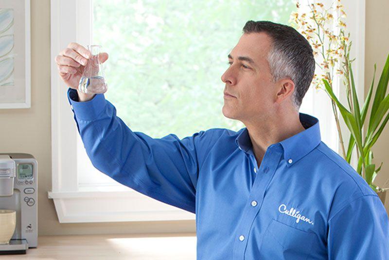 Man holding beaker